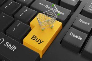Carrito de compras sobre computadora
